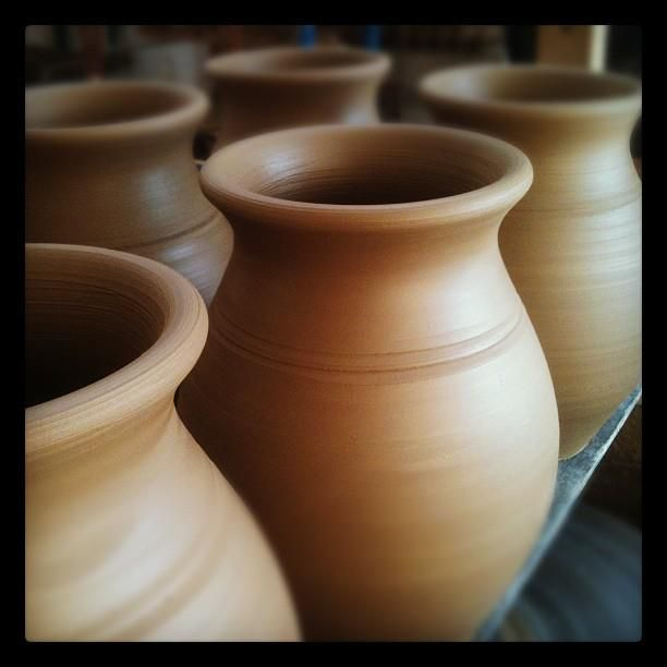 Newly hand thrown 2 pint Jugs. The clay is left to dry slightly before the spouts are pinched and the handles put on. Stephen Pearce Pottery.
