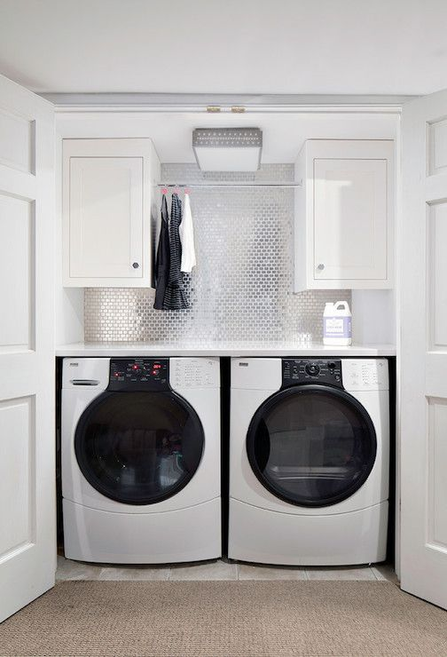 Clean Design Partners - laundry/mud rooms - concealed laundry area, hidden laundry area, double doors, laundry room doors, white counter, wh...
