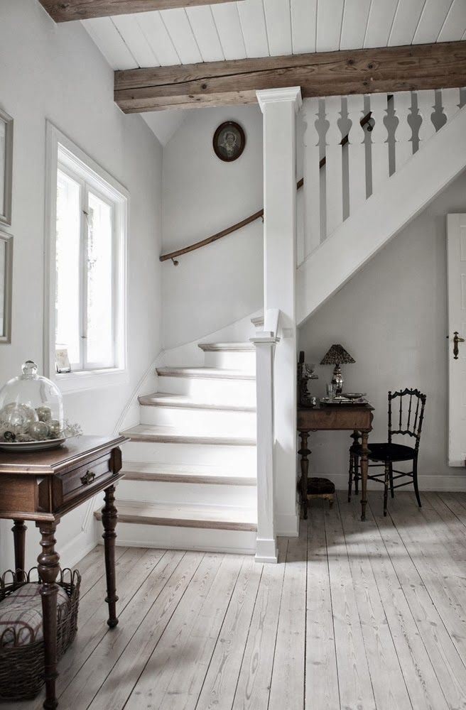 hall/stairs: pale floors + rustic beams