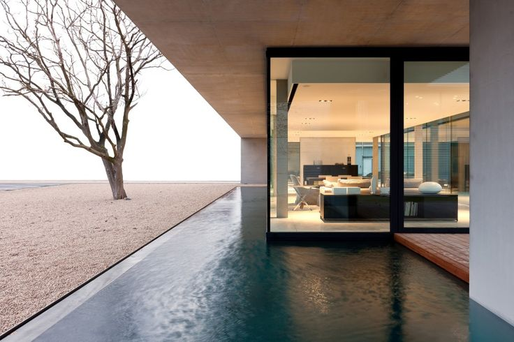 Obumex Outside is a minimalist house located in Staden, Belgium, designed by Govaert & Vanhoutte Architects. The new volume is an natural extension of the massive existing buildings. (12)
