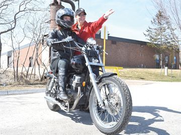 Barrie motorcycle enthusiasts cautioned - Motorcycle student Amanda Tribbeck receives a lesson from senior instructor Sharie Payne at Georgian College Monday. She is taking lessons to help ensure her safety on the road.