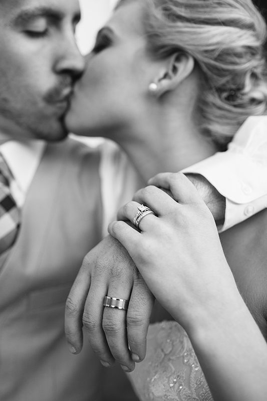 Love this. A sweet kiss that shows off the rings.