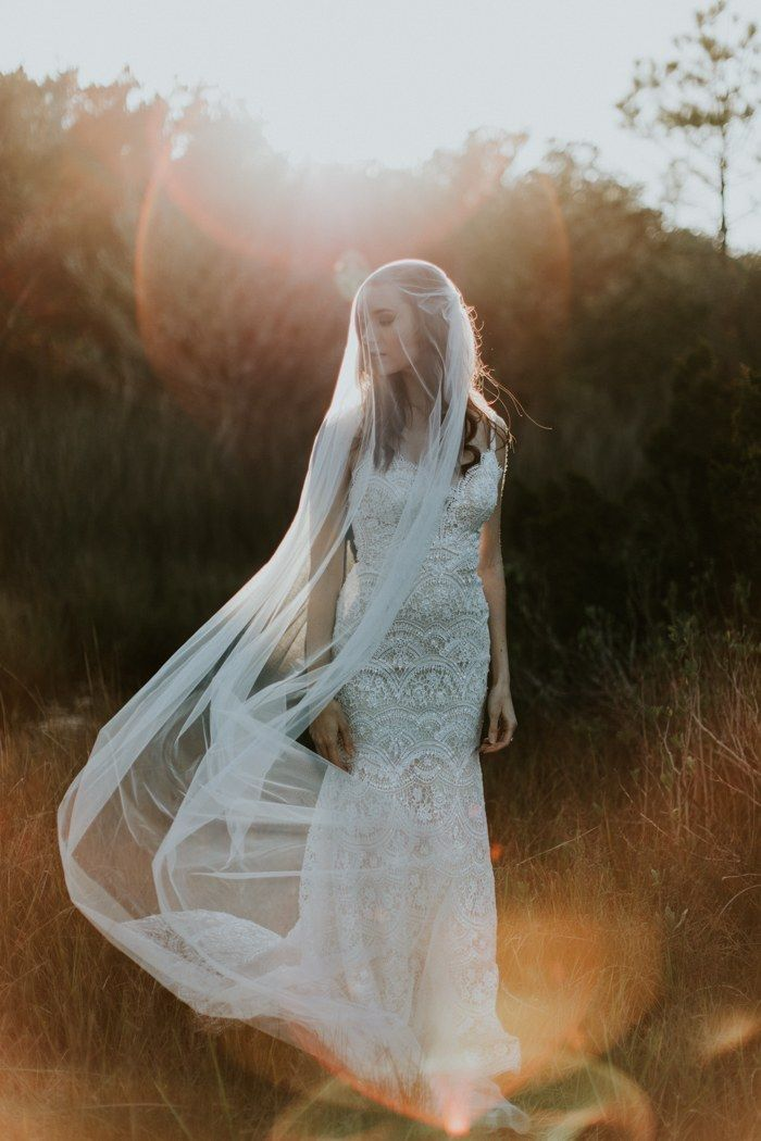 Can't get over this stunning + windswept bride captured by Hazel Eyes Photography