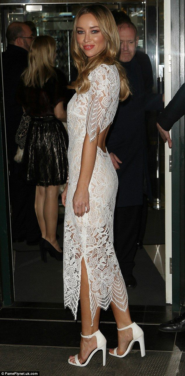 Elegant: Lauren Pope opted for a more demure look in a long white lace dress