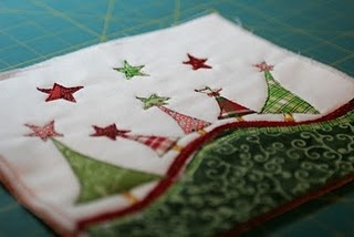 whimsical Christmas tree mug rug  I'd love to take this design as a basis for a pillow or tablerunner.
