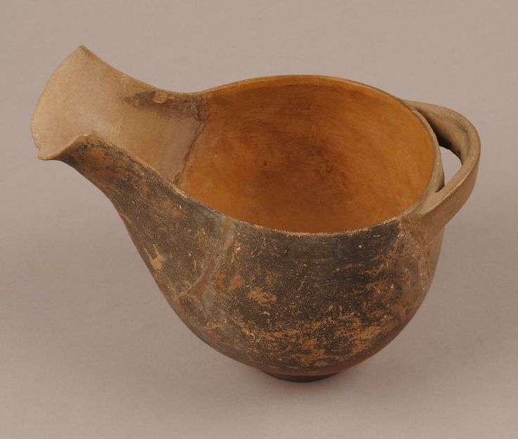 Pottery jug, also known as a 'sauceboat'. Brown-black slipped outside. One side and base restored in plaster. Keros-Syros Culture term details Date: 2800BC-2300BC Production place: Made in: Cyclades