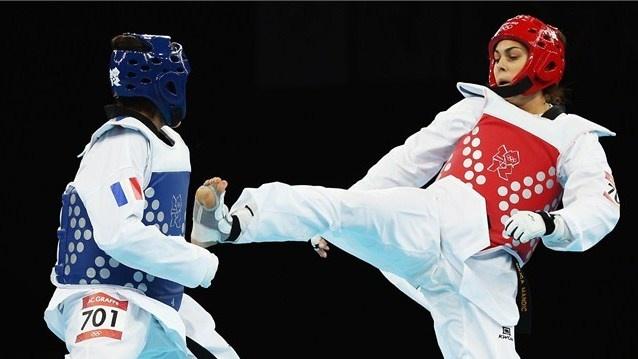 Anne-Caroline Graffe of France competes against Milica Mandic of Serbia