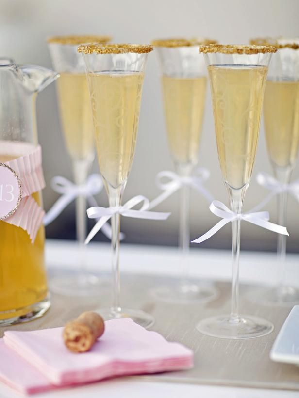 Dress up your champagne glasses for by dipping rims in water + gold sugar sprinkles via @HGTV