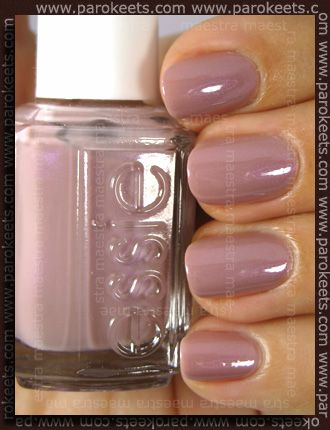"Essie Demure Vixen.  My all time favorite nail polish color.  It is my new ""go to"" color.  Neutral enough to wear with everything but still a little hint of color that compliments my skin tone which is light olive.  Soft feminine color, ever so tiny bit iridescent just enough to catch the light and very shiny.  Beautiful!"