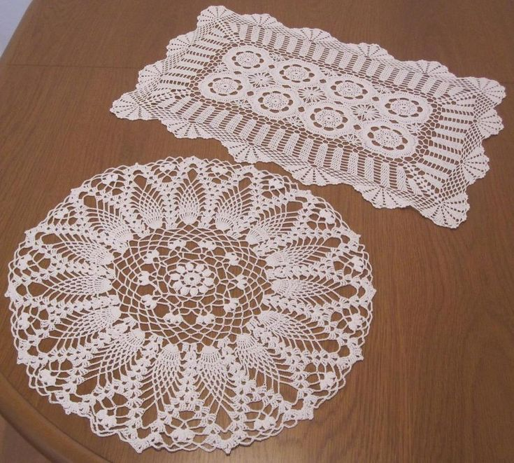 Two Large Two Large Vintage Hand Crochet DOILIES 45cms x 28cms 36cms Diameter Crochet is in White Cotton Thread NEVER USED Stored over a long period of time so I have  *Laundered *Starched *Ironed  to freshen up so comes to you ready to use. Hand Crochet DOILIES in White 'Never Used'
