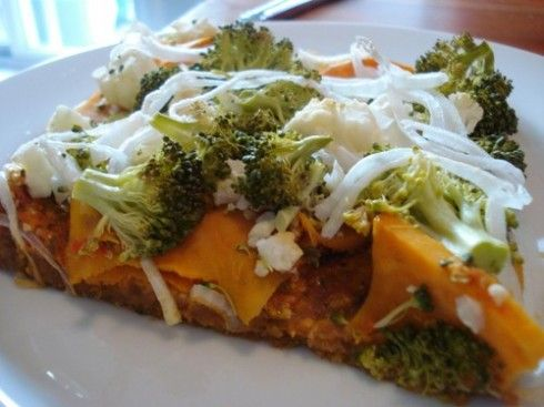 Chickpea Curry Pizza -- a recipe from triathlete and ultramarathoner Brendan Brazier - try subbing out the oil in the crust with pumpkin or sweet potato