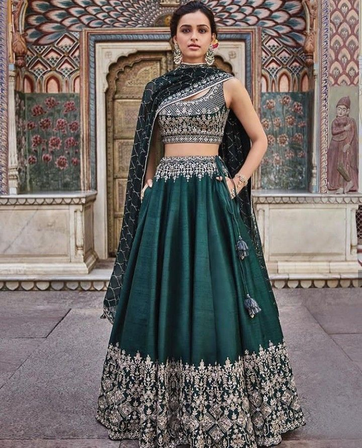 99f2285cc4c9a1 Beautiful Raw Silk Lehenga with traditional hand embroidery embellishments.