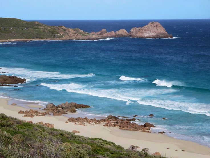 Sugarloaf Rock is an unusual conical feature jutting out into the Indian Ocean near Cape Naturaliste in Western Australia.