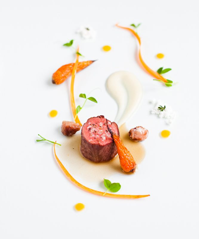 Beef tenderloin with veal jus, pickled carrots, roasted carrots, potato puree, carrot puree, truffle oil powder, pea shoot tendrils and roasted bone marrow.