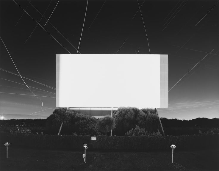 """4/4 - Hiroshi says that his dream was to capture 170,000 photographs on a single frame of film. The image he had inside his brain was of a gleaming white screen inside a dark movie theater. He says that the, """"the light created by an excess of 170,000 exposures would be the embodiment or manifestation of something awe-inspiring and divine."""""""