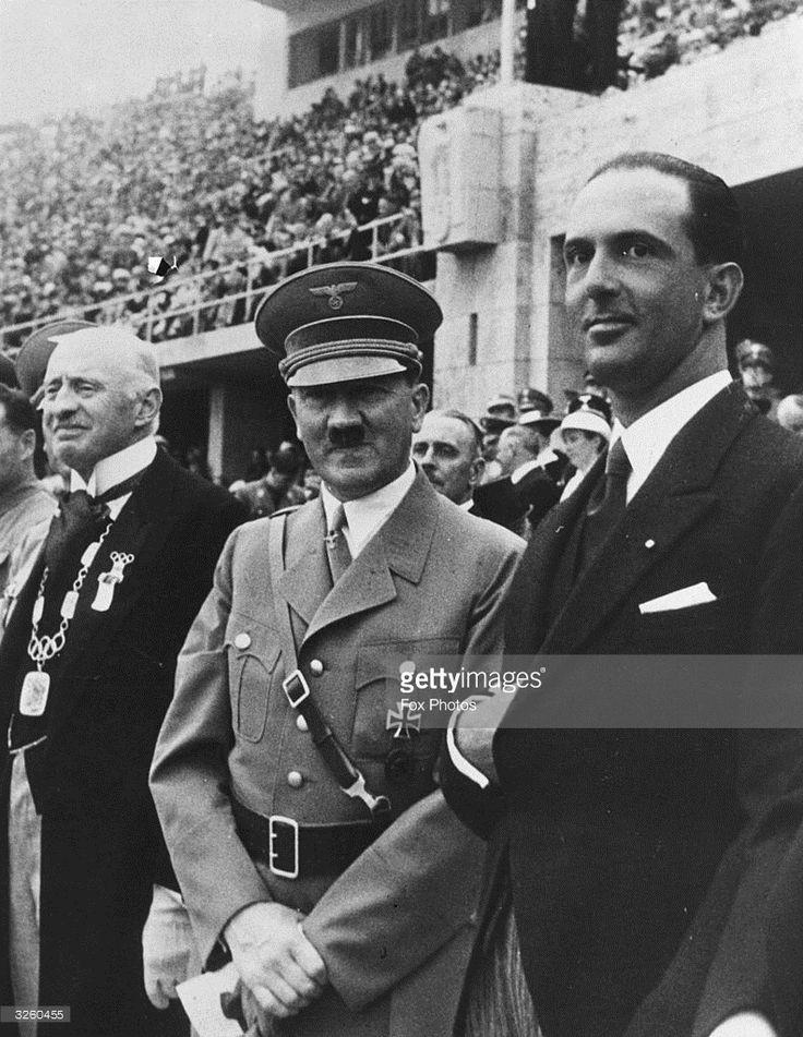 German dictator Adolf Hitler (1889 - 1945) standing with Italian Crown Prince Umberto (later King Umberto II), watching the Olympic Games in Berlin.