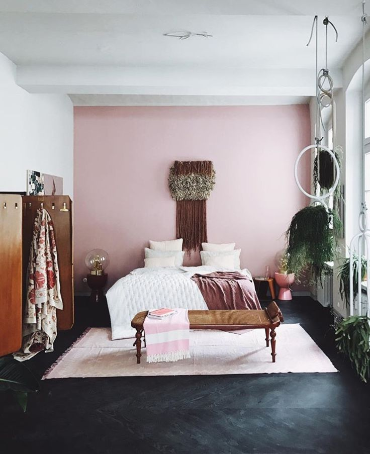 Accented Neutral Color Scheme Bedroom: Dark Floors, Pink Accent Wall, Wood Tones And Neutral