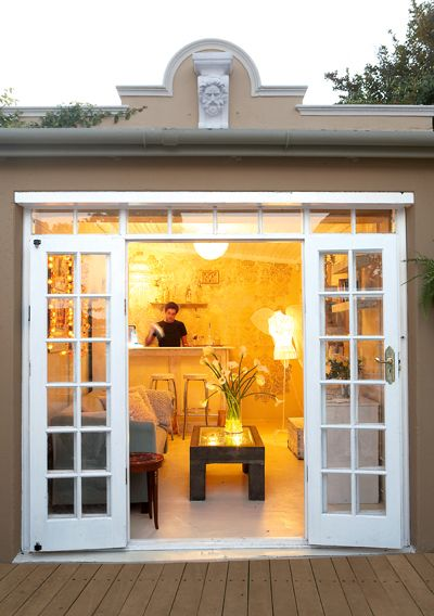 Garage to French doors. Love the side and upper windows. Without panes for Dan?