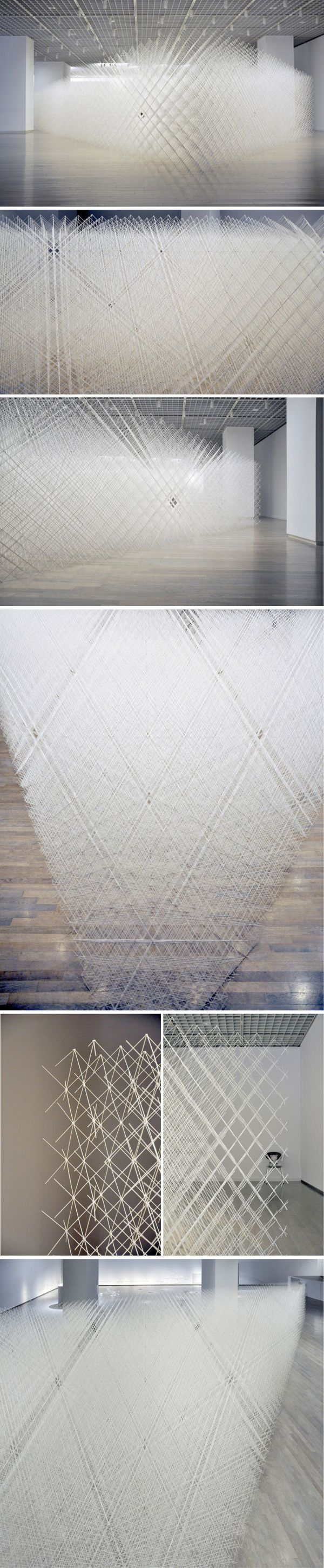 Ryuji Nakamura | Cornfield, a large scale installation, is a right triangle consisting of 30°, 60° and 90° angles. Constructed solely of glue and paper the delicate structure and lace-like appearance of the material softens the rigorous geometry of the art object.
