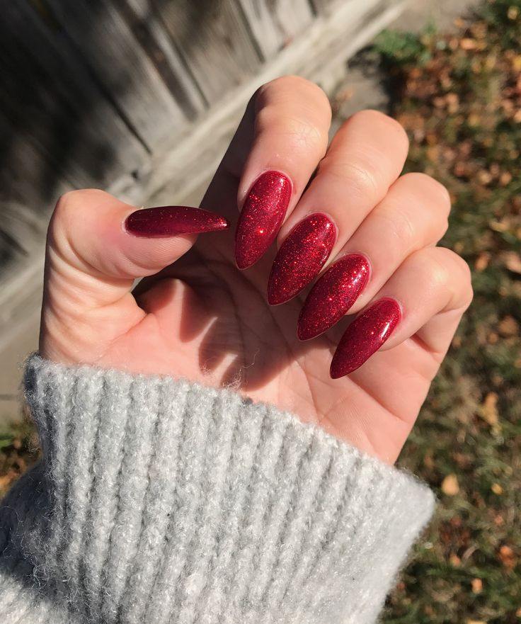 Acrylic red sparkly almond shaped Halloween nails | Red ...