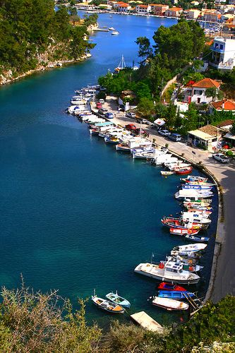 This is my Greece | Sea canal lined with boats and vegetation in Gaios on Paxos…