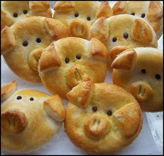 Lil Piggy Biscuits stuffed with ham and cheese. How can you not want to eat every last one! From Pennsylvania Cooking.