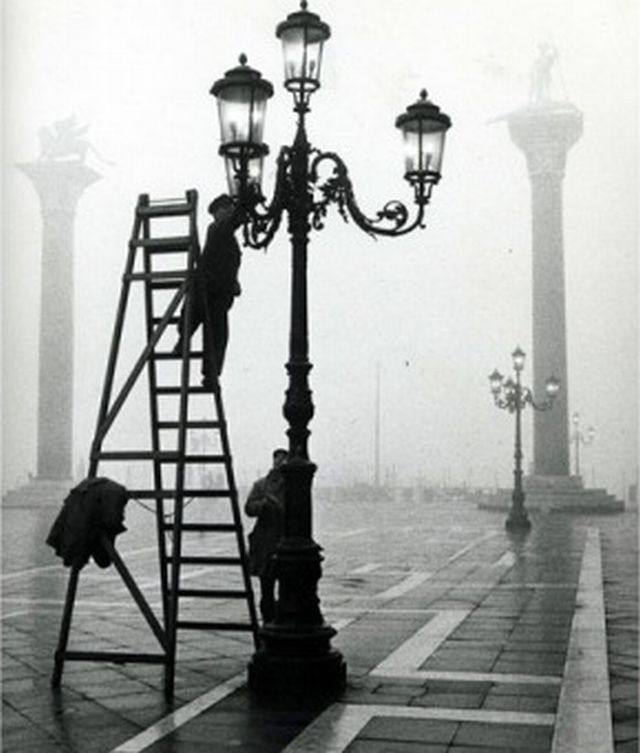 """Lighting the street lamps in San Marco Square, Venice"" 1955, photo by Italian photographer GIANNI BERENGO GARDIN (born 1930)"