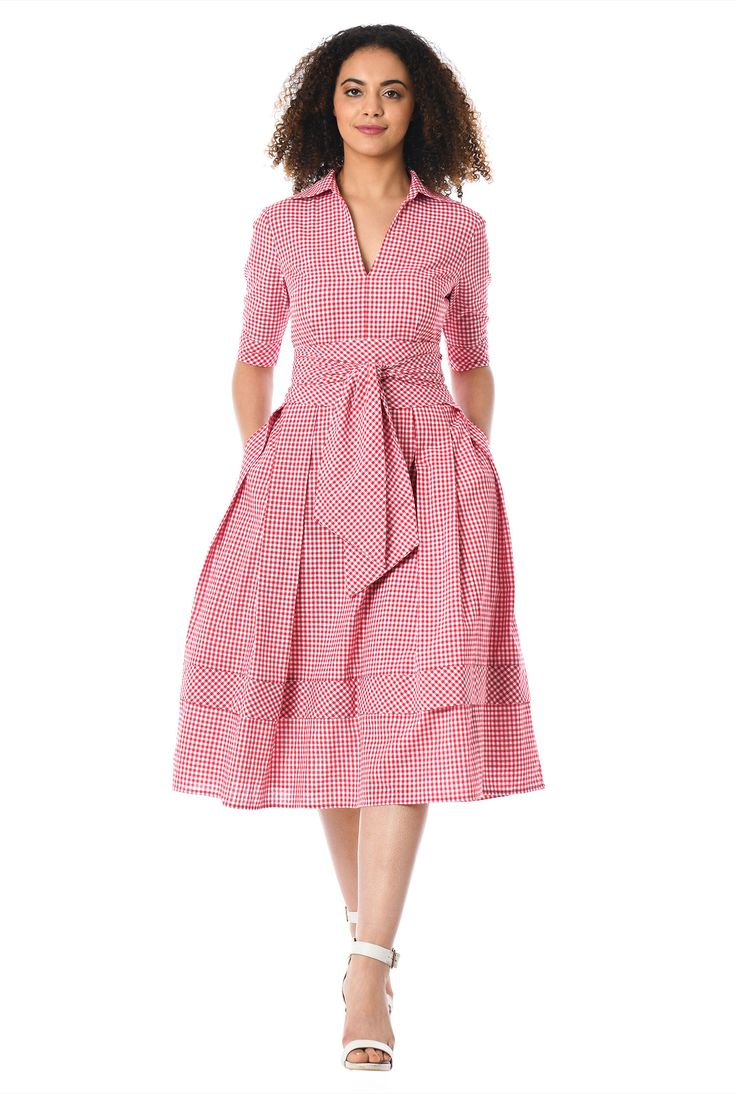 Our gingham check print cotton dress is cinched with a wide obi style sash tie belt and tailored with inverted pleats and banded hem at the full skirt.