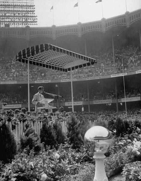 Jehovah's Witnesses Convention at Yankee Stadium is opened by Convention Chairman Grant Suiter. 1950