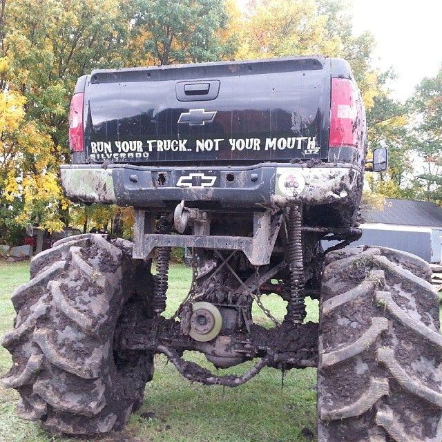 jacked up chevy trucks mudding - photo #19