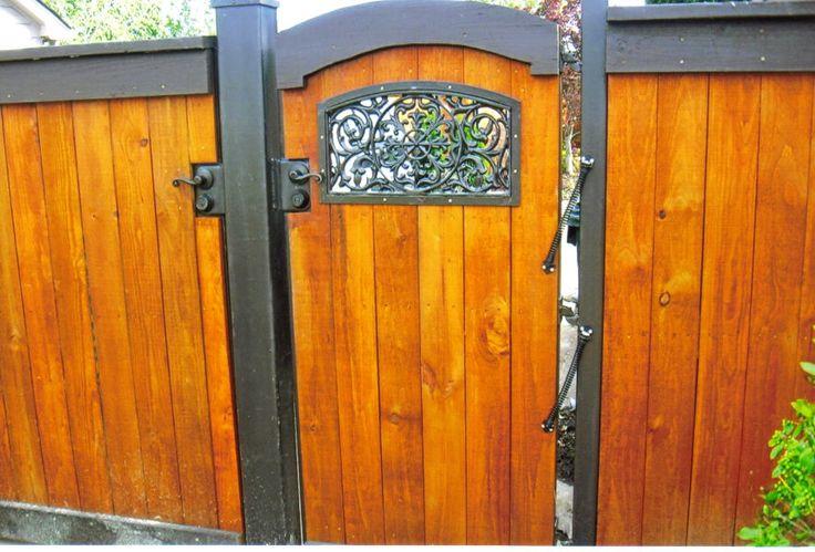 Custom Arch Top Cedar Fence With Ornamental Iron Features
