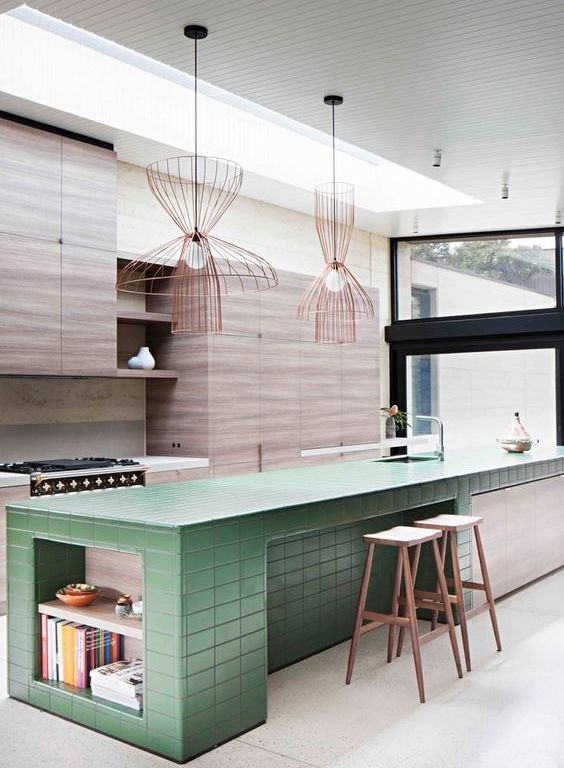Light kitchen in pastel green with modern assymetric bulb lighting.