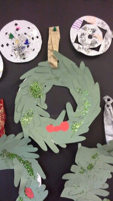Using our hand prints to make a christmas wreath