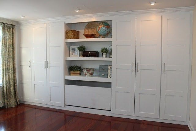 """Materials: PAX Wardrobe Description: We started with 2 wide PAX units and 2 narrow PAX units. Our ceilings are not even 80″ but our height options at IKEA were 96″ or 75″.€ We rolled the dice, bought 96"""" units. Using a chop saw we cut them down to 80″ and assembled using the instructions that …"""