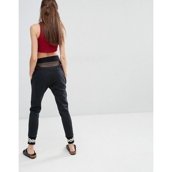 Reebok Classics Sweatpants With Ankle Logo In Black (£55) ❤ liked on Polyvore featuring activewear, activewear pants, black, reebok sportswear, relaxed fit sweatpants, reebok sweatpants, cuff sweat pants and tall sweat pants