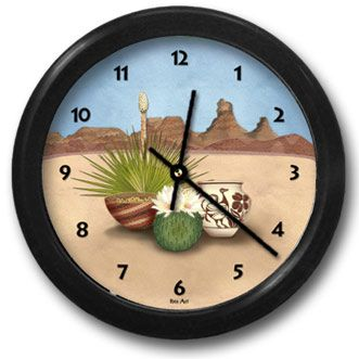 Desert Treasures Round Acrylic Wall Clock - From our Southwestern Clocks category, this clock is inspired by the rock formations and cacti found in the Southwestern desert. In the foreground are blooming cactus, Native American pottery and baskets.  $38.00