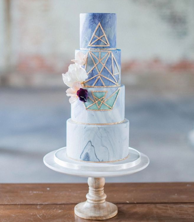 For a unique touch, consider a marbled cake with geometric details.