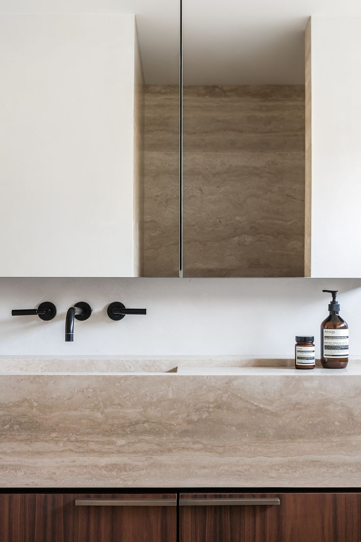Travertine bathroom by Dieter Vander Velpen Architects / Photo by Thomas De Bruyne