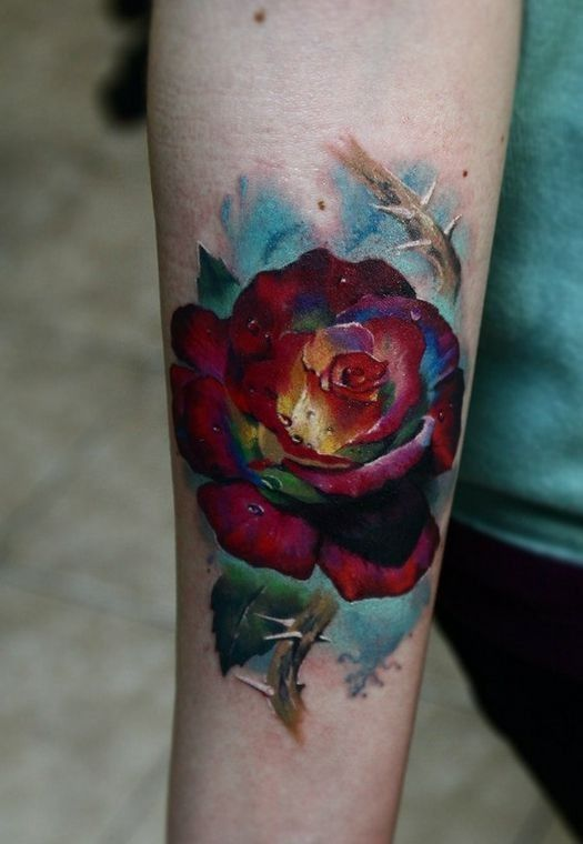 Colorful photorealistic rose tattoo on arm