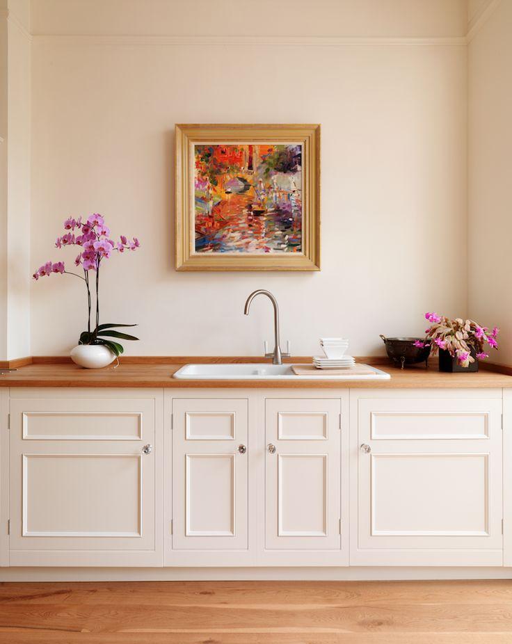 Harvey Jones Original kitchen, painted in Dulux 'Natural Calico'.  http://www.harveyjones.com/our-kitchens/original-kitchens/original-open-plan-customised-splashback