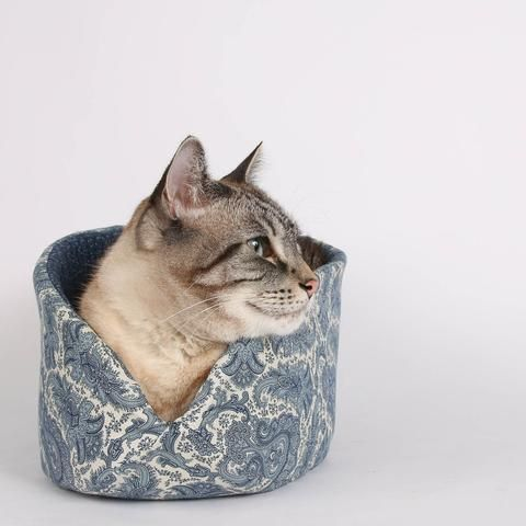 The Cat Canoe is a modern cat bed designed and manufactured by The Cat Ball, LLC. Our modern cat nest is a washable pet bed