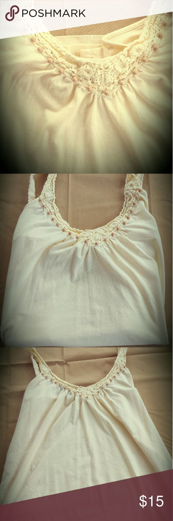 Super Soft Ann Taylor Pale Yellow Cami Top In typical Ann Taylor fashion, this cotton and spandex top is sexy and soft.  With crocheted  straps and wooden embellishments  it is a delicate and a lovely cami/shell/tank top perfect for any outfit. Ann Taylor Tops Tank Tops