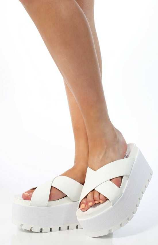 These super chunky Birkenstock Sandals are all over off-white and feature two cross over straps and an incredible layered flatform with teeth-sole detailing.  $109.00
