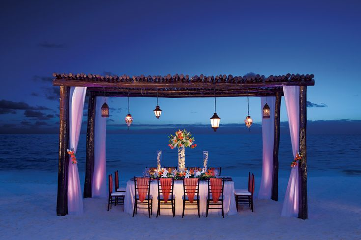 vacationsbyvip.com | Private dinner set up on the beach for a small group at Secrets Capri Riviera Cancun.