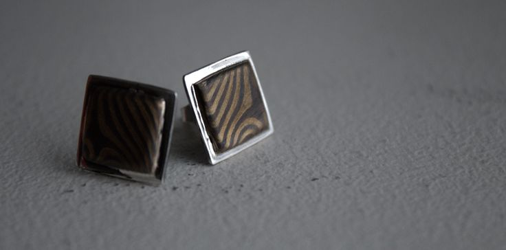 Handmade Sterling silver earrings with Mokume gane pieces. Mokume gane made from copper and brass.