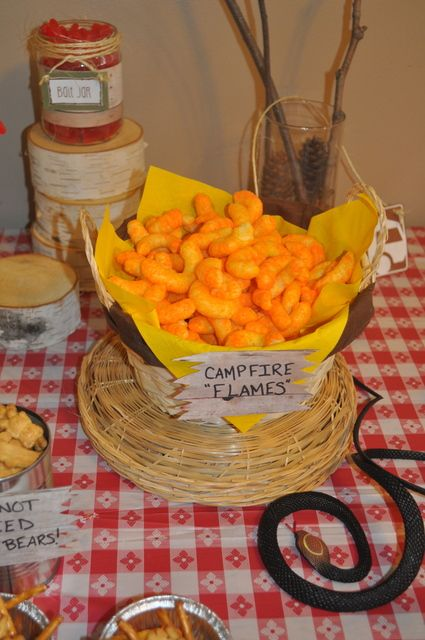 "Food table (not dessert table) ideas:  Chips-- creatively named ""campfire flames"""