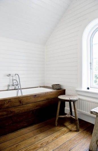 White and wood bathroom - continue wood tiles up the side bath panel