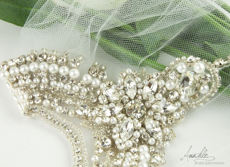 'Avalon'  This stunning hand crafted bridal veil will complement a wide range of hairstyles. The rhinestone and white pearlesque bead motif is hand sewn onto bridal tulle and fastens into the hair with two small silver combs at the top of each point.  www.facebook.com/Amahlebridal