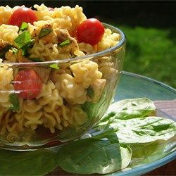 The perfect picnic pasta salad! Chopped chicken combines with toasted sesame seeds, spinach and green onions, all marinated in a sweet and tangy soy and vinegar-based dressing.