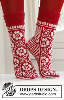 "On Your Toes! - Knitted DROPS Christmas socks in ""Fabel"" - Free pattern by DROPS Design"